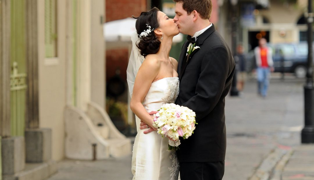 Matthew and Huyen sharing a French Quarter kiss as man and wife