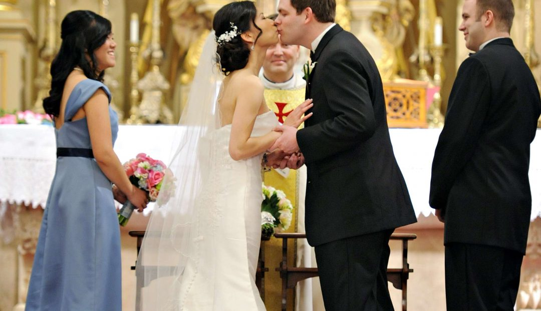Matthew and Huyen share their first kiss as man and wife